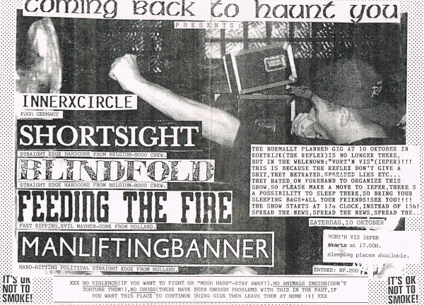 92-10-10 Man Lifting Banner - Feeding The Fire - Blindfold - Shortsight